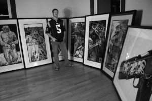 John Beckmann with many framed big fucking monsters in Tim Tebow jersy